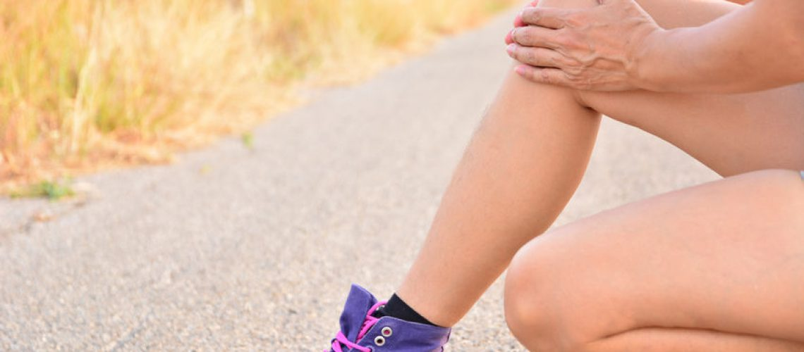 72630175 - closeup legs skin on road and under the sky for health care concept
